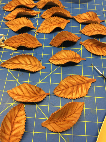 hand-cut leather leaves vegetable tanned