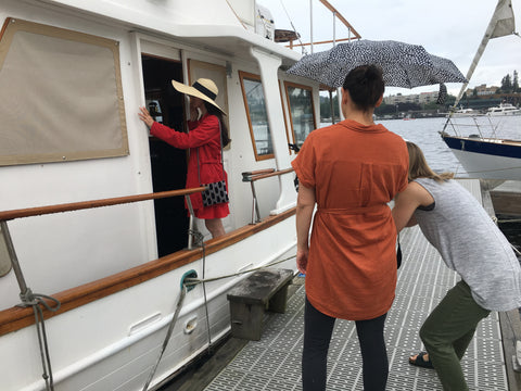 rainy photoshoot in seattle on a vintage sailboat in lake union