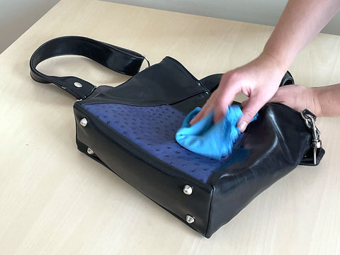 Photo of cleaning your bag with a damped cloth