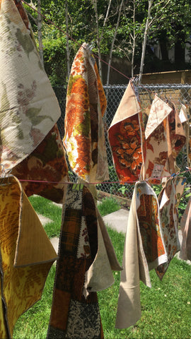 vintage fabrics hanging outdoors on a clothesline