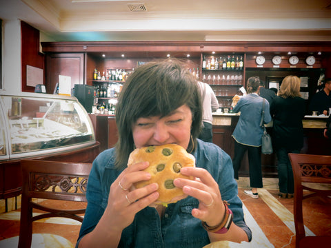 crystalyn kae eating vegan focaccia in italy