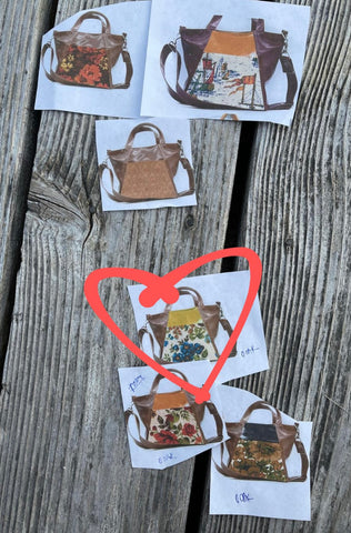 cut outs of bags on deck with a heart circled on the best bag