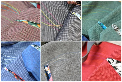 detail of tweed bags with colorful topstitching