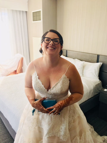 bride with her custom blue clutch