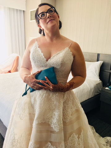 blue clutch for bride on her wedding day