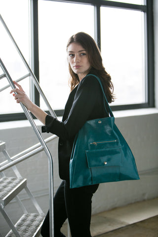 woman climbing the corporate ladder with a purse