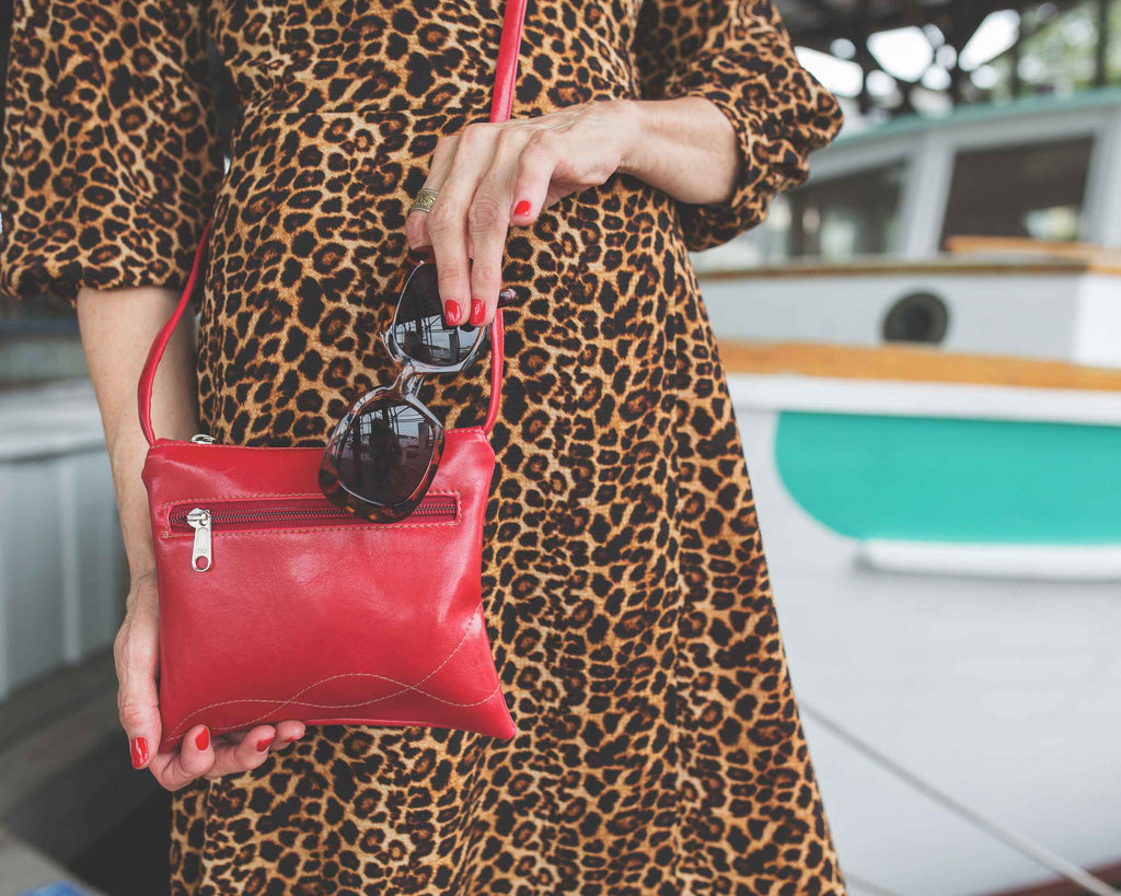 woman in leopard print dress wearing Cha Cha Small Crossbody Bag - Cherry Red Vegan Leather