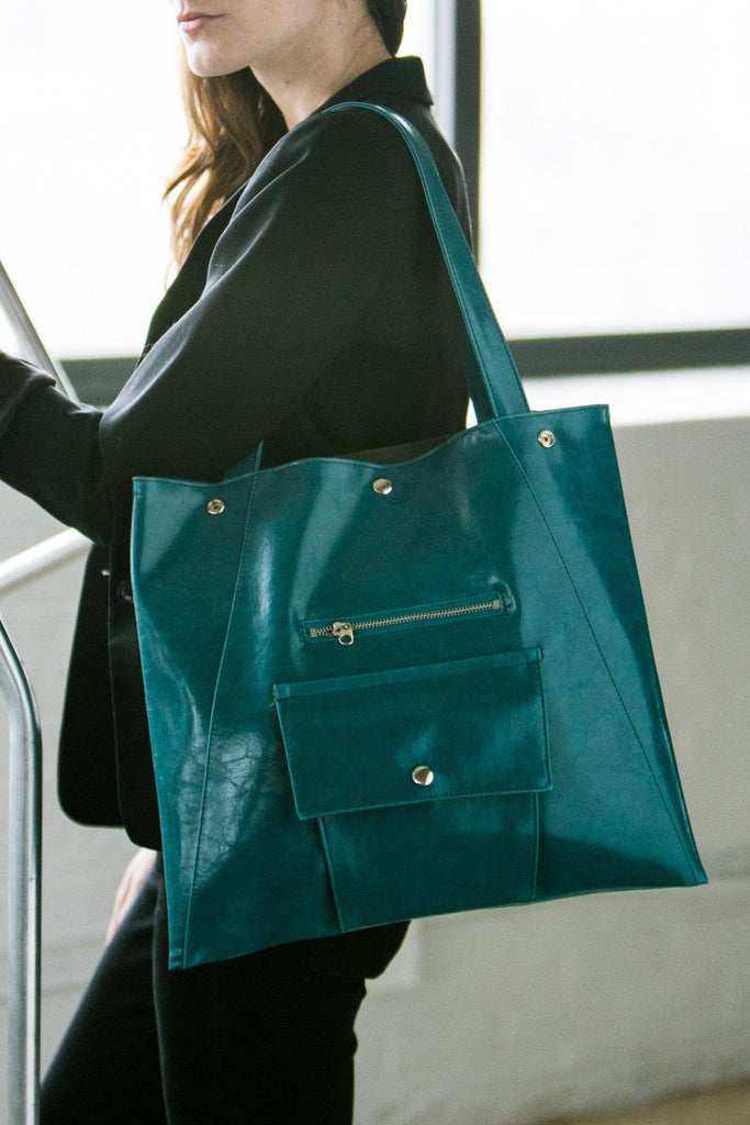 woman wearing Teal Tote Bag - Metier Tote - Teal Vegan Leather