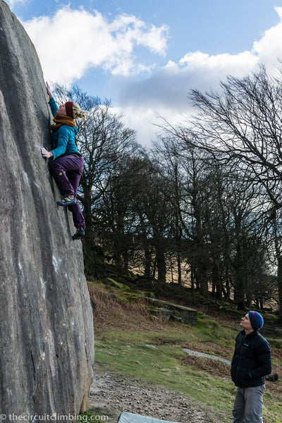 Michaela testing her SKAT's on the Pebble Boulder, Stanage Plantation