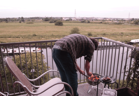 Marc boasting his balcony BBQ and barges
