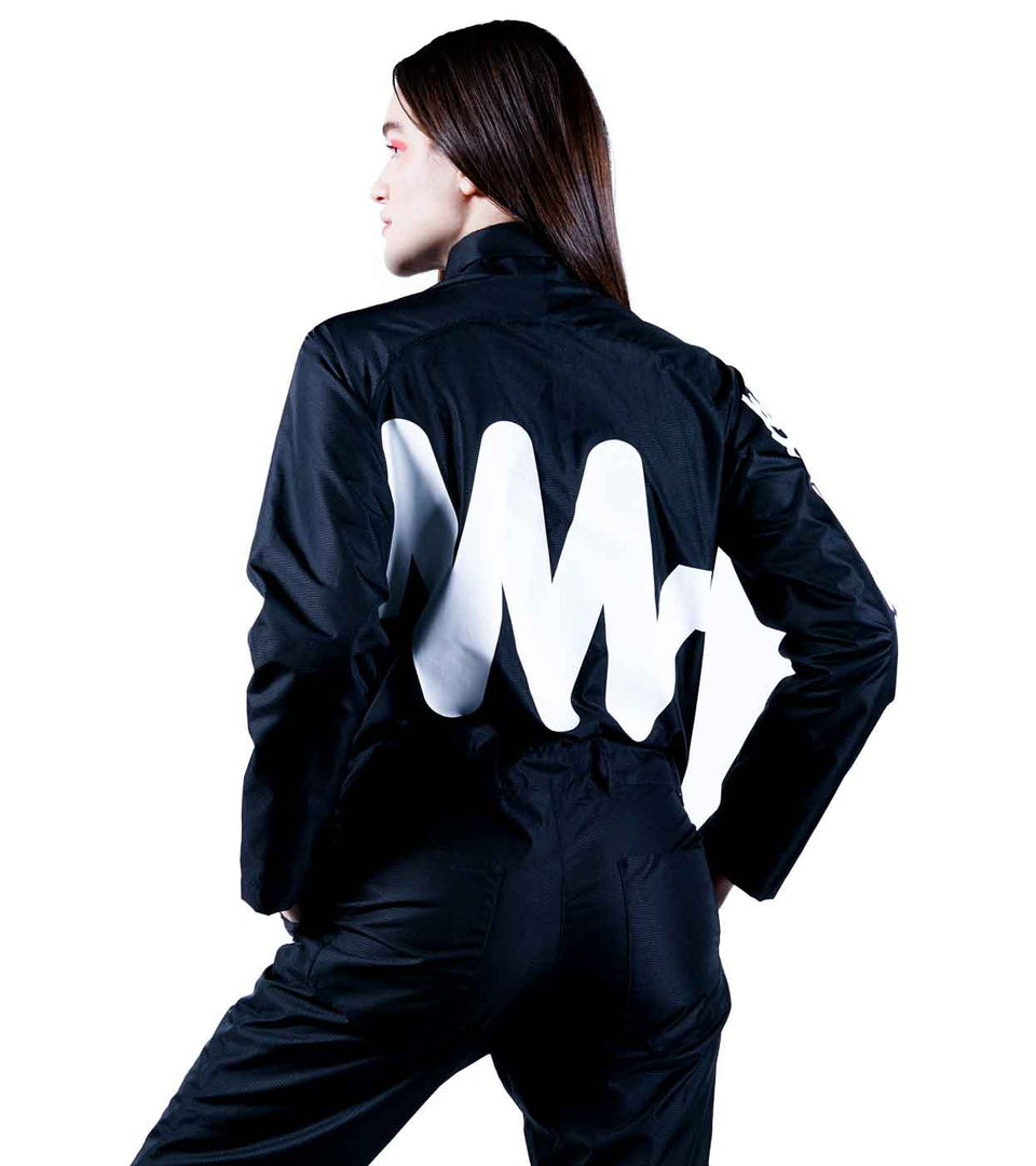 back view of a women fashion tech black jumpsuit with a resistor white symbol print