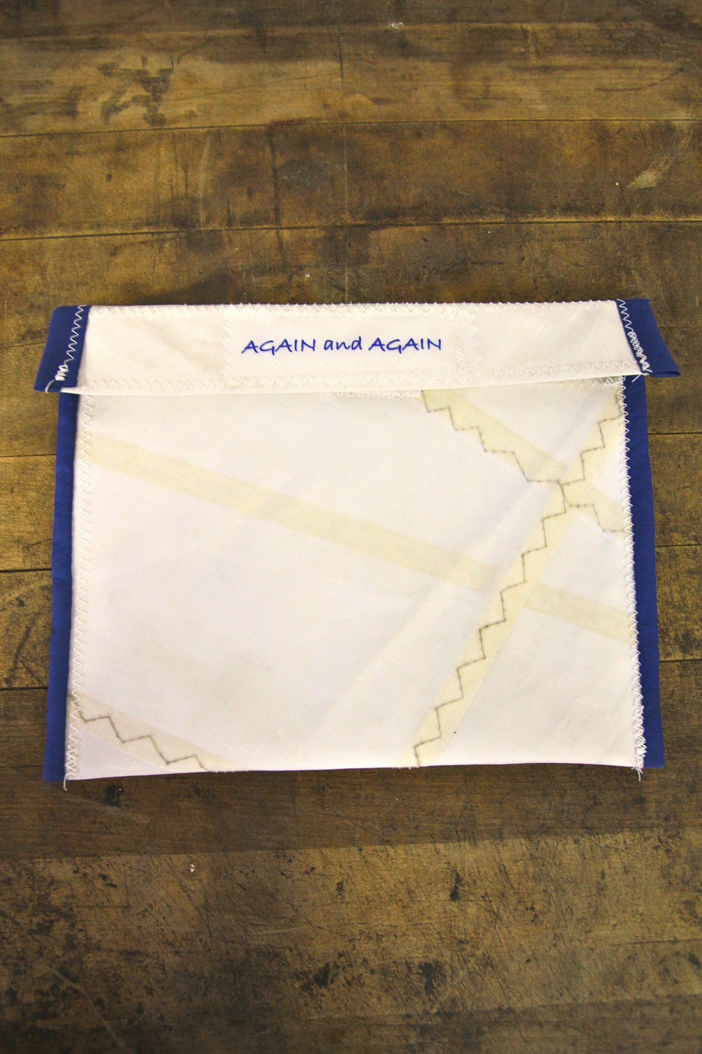 AGAIN AND AGAIN Large Pouch Blue Trim