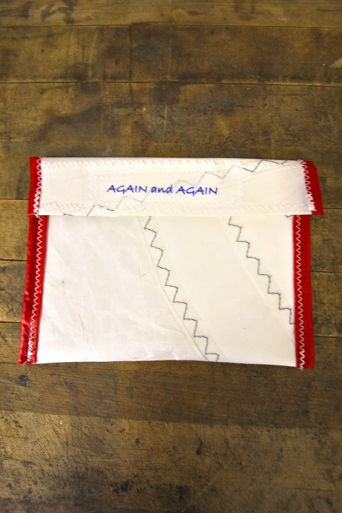 AGAIN AND AGAIN Pouch Red Trim