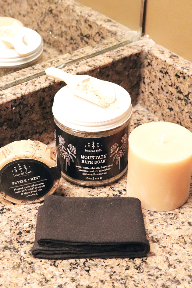 You deserve a spa day package contents on bathroom counter