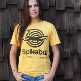 Female Wearing Heather Gold Join The Movement Spikeball T-Shirt Outdoors