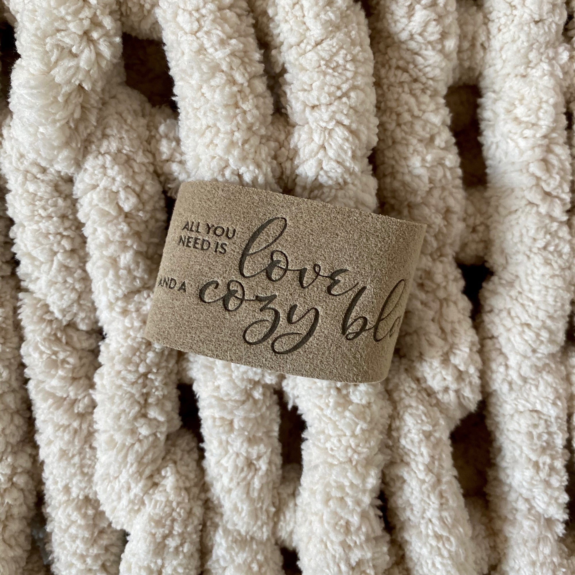 """All you need is love and a cozy blanket."" LoveSnap on Infinite Love Blanket in Oat"