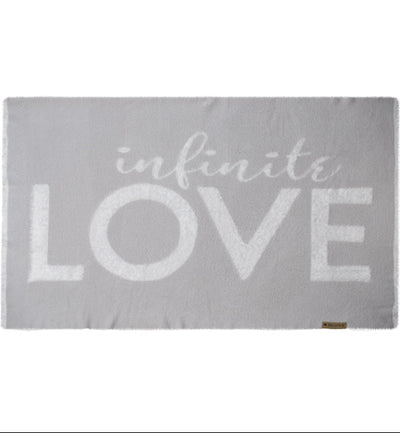 Love Blanket from the Dream Collection, white background, light grey blanket, micro-chenille and feather yarn