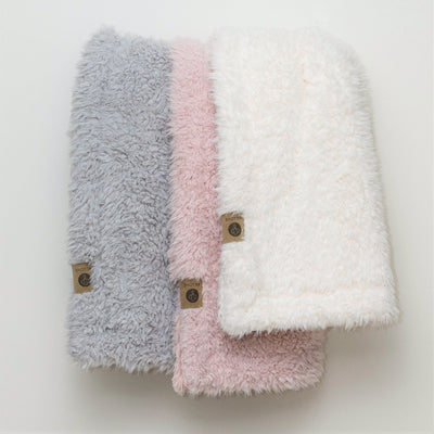 Stacked blankets with llama fabric  from the  Guardian Angel Collection in: Silver Cloud, Dusty Pink, and Whisper White