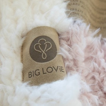 Close up of Love Snap label on a Guardian Angel Blanket, plush llama fabric