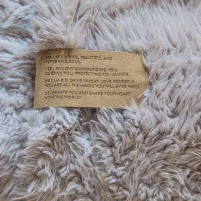 Close up of a Love Snap label with text, on a Silver Cloud Guardian Angel Blanket