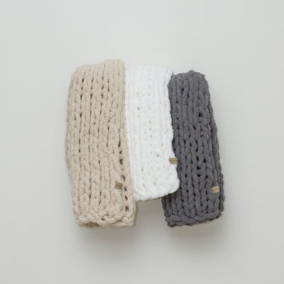 Staked chunky knit blankets from the Little Infinite Love Collection in: Oat, White, and Slate
