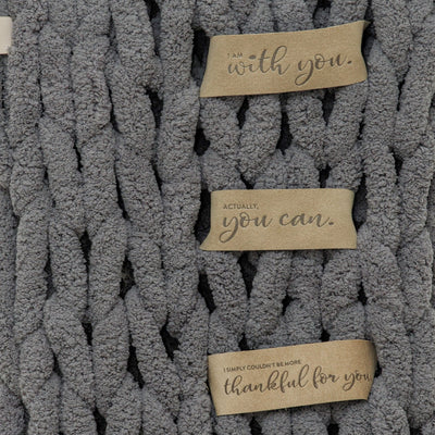 Close up of LoveSnaps on Big Infinite Lovie in Slate, soft and pliable Ultrasuede
