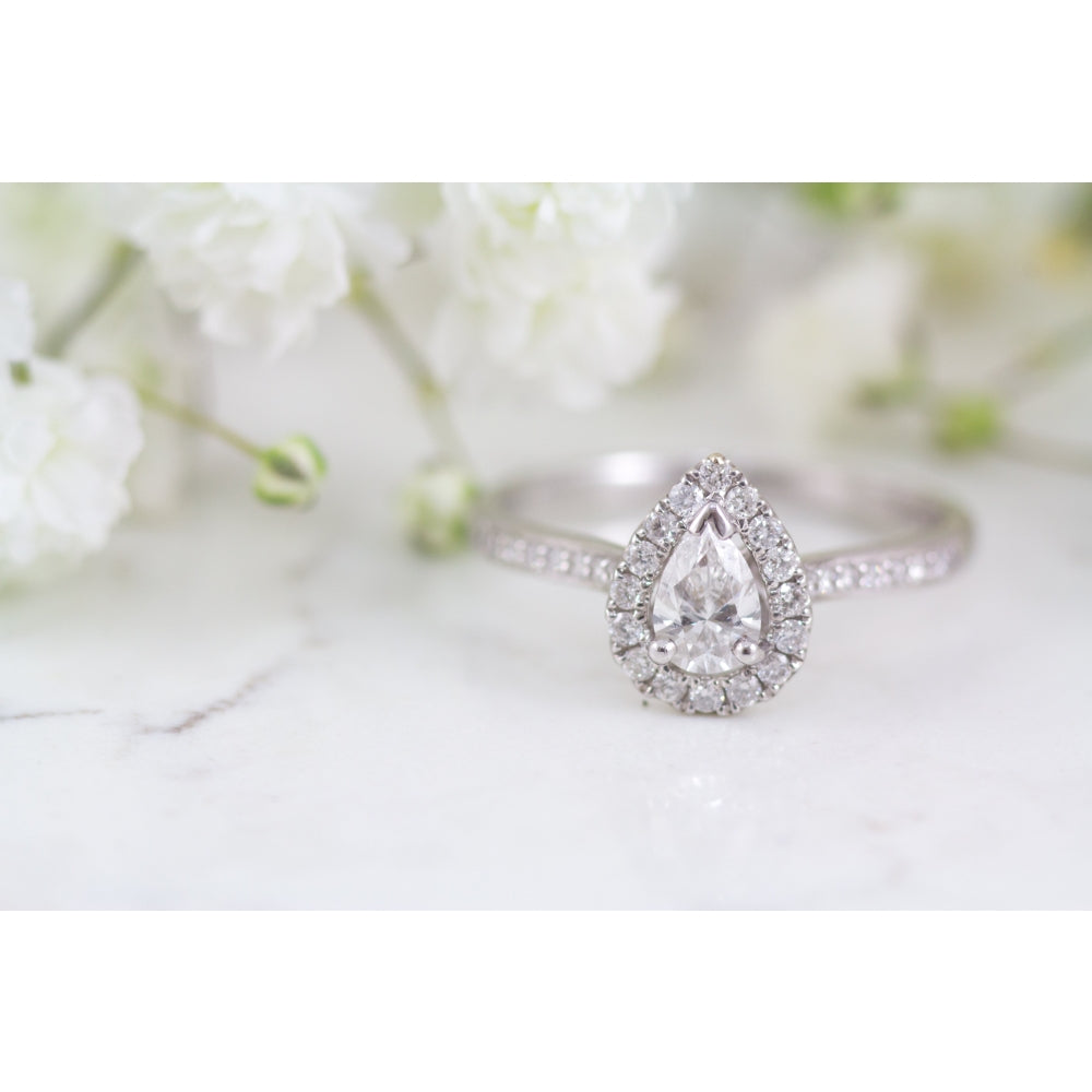 18 carat white gold pear shape halo engagement ring.