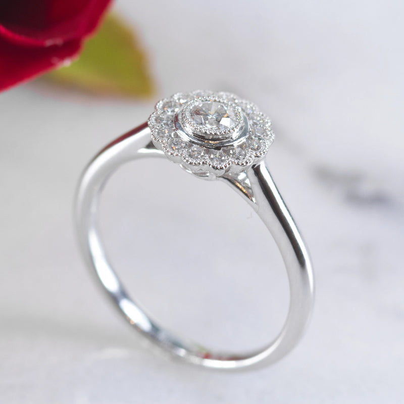 Dora 18ct white gold floral style engagement ring