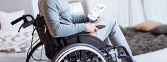 Young man in wheelchair suffering from UTI
