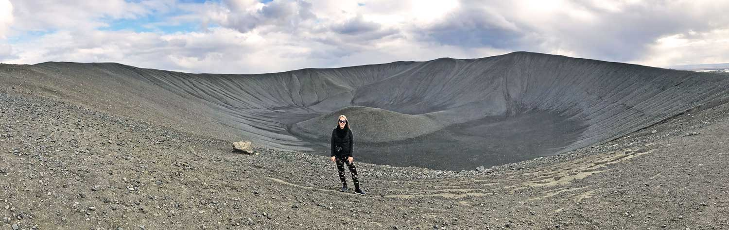 About busyXploring Audrey Rattay standing infront of volcano in Iceland busy exploring