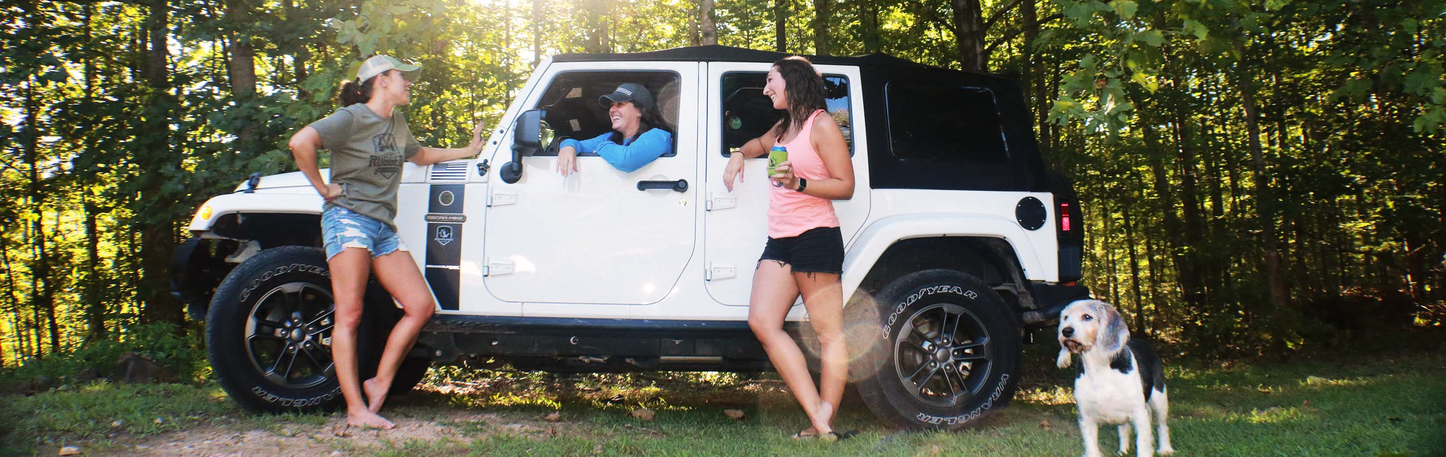 Careers @ busyXploring - Girls standing infront of white Jeep wearing nature inspired apparel from busy exploring