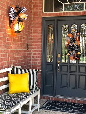 White Bench with Black and White Pillows, Gold Pillow for Halloween | Designer Ribbon Halloween Bow on Porch Lantern | Halloween Door Decor by Miss Cayce's Christmas