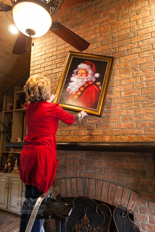 Kathy places a Santa painting to start her Country French Christmas mantel!