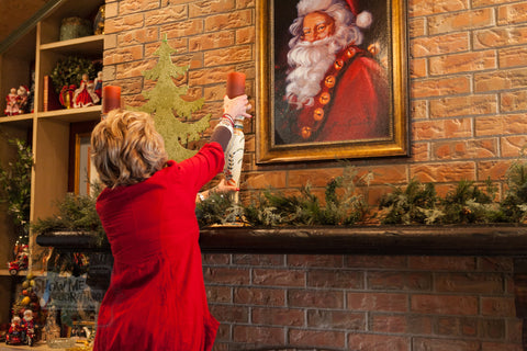 Everyday home decor is used in decorating this Christmas mantel. Battery operated candles create a warm glow.