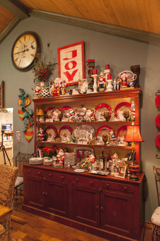 Hutch decorate with Christmas Dishes and McKenzie Child