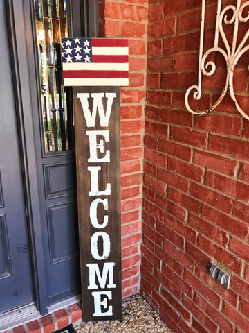 Glory Haus Welcome sign with American flag