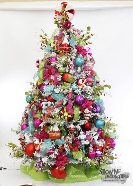 Colorful Christmas Tree - This colorful, fun, candy #christmas tree will go great in your kitchen! Everything you need is athttp://www.showmedecorating.com/collections/christmas-confection-tree-theme.