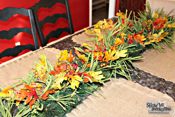 Fall centerpiece idea! Layer with other floral garlands.