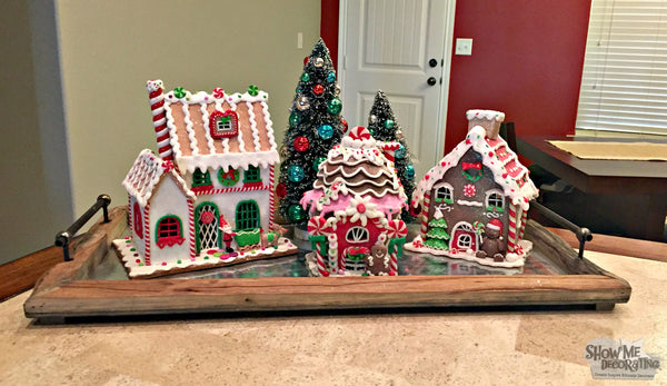 Show Me a gingerbread house neighborhood, a tray pulls the whole look together