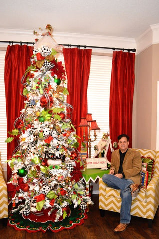 Mark Roberts next to Christmas tree