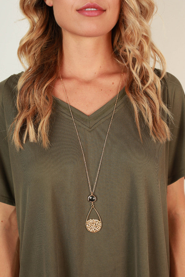 Wink Your Way Necklace in Champagne