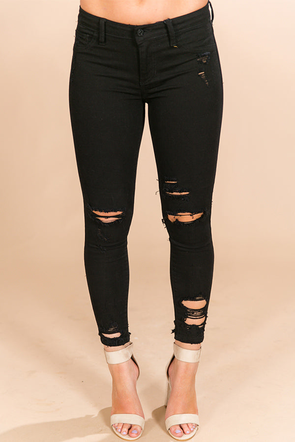 The Lola Midrise Distressed Skinny in Black