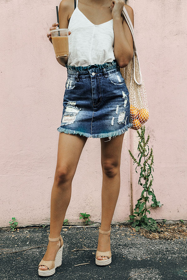 The Chloe Distressed Denim Skirt in Medium Wash