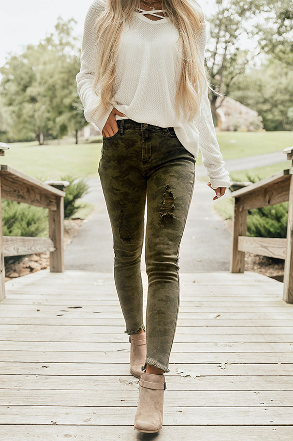 The Cassie Mid Rise Distressed Camo Skinny