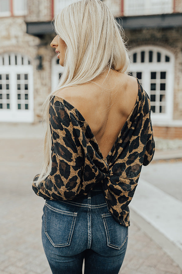 Cozy Jet Setting Leopard Twist Back Sweater In Mustard