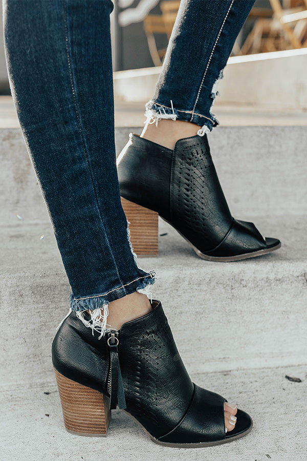 The Baylor Faux Leather Peep Toe Bootie In Black