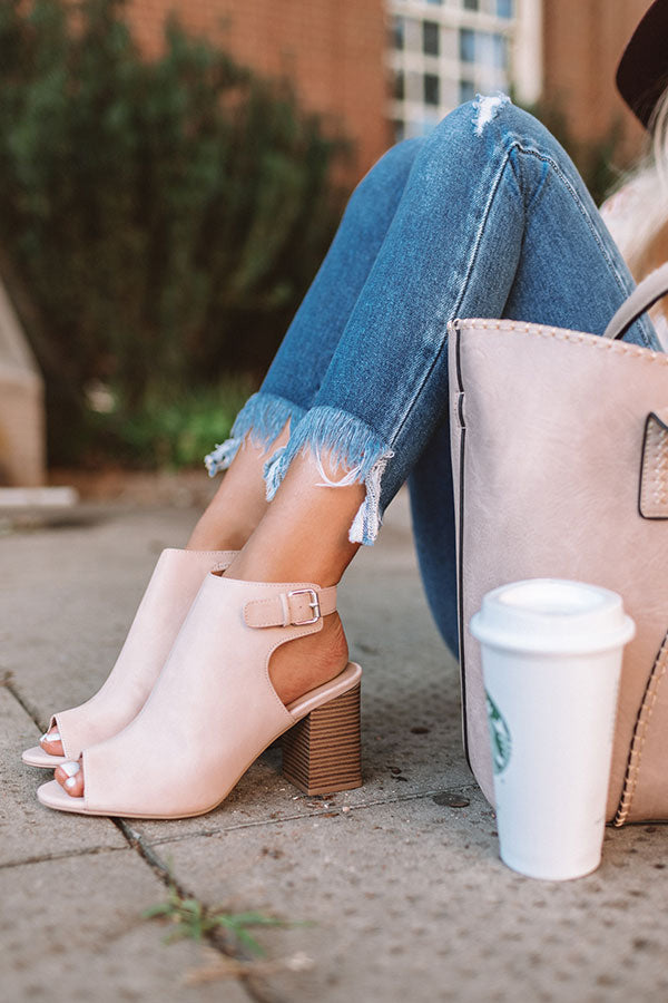 The Pryor Faux Leather Peep Toe Bootie In Blush