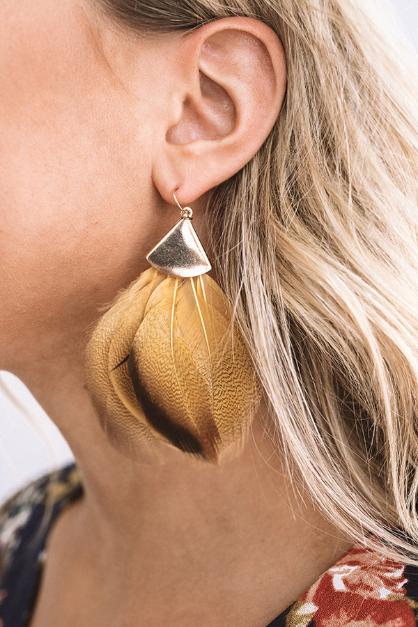 Feeling Flirtatious Feather Earrings In Mustard