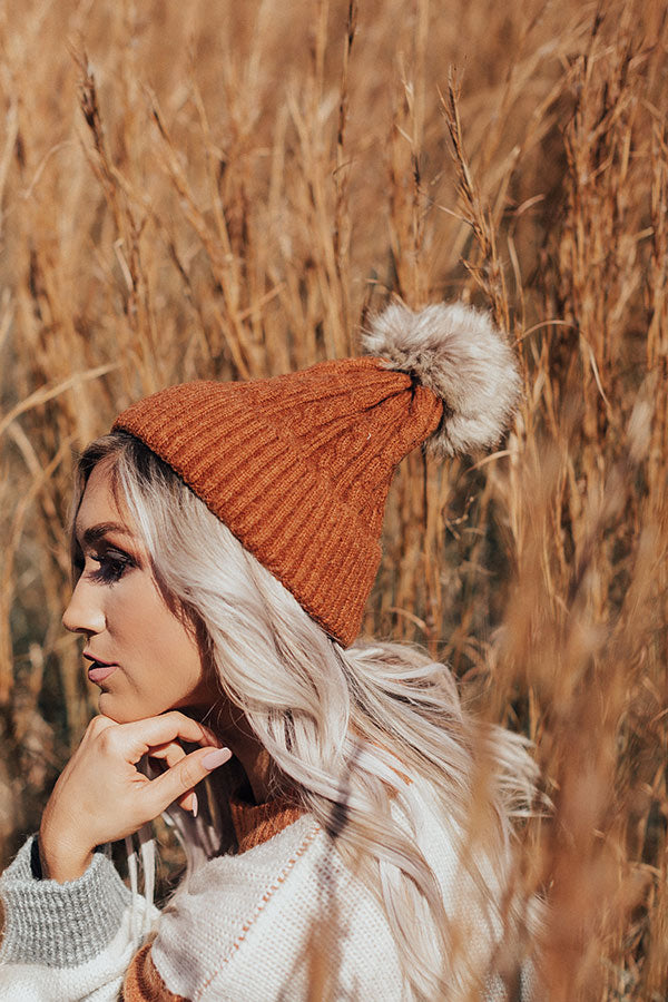 In The Know Faux Fur Pom Beanie In Dark Rust