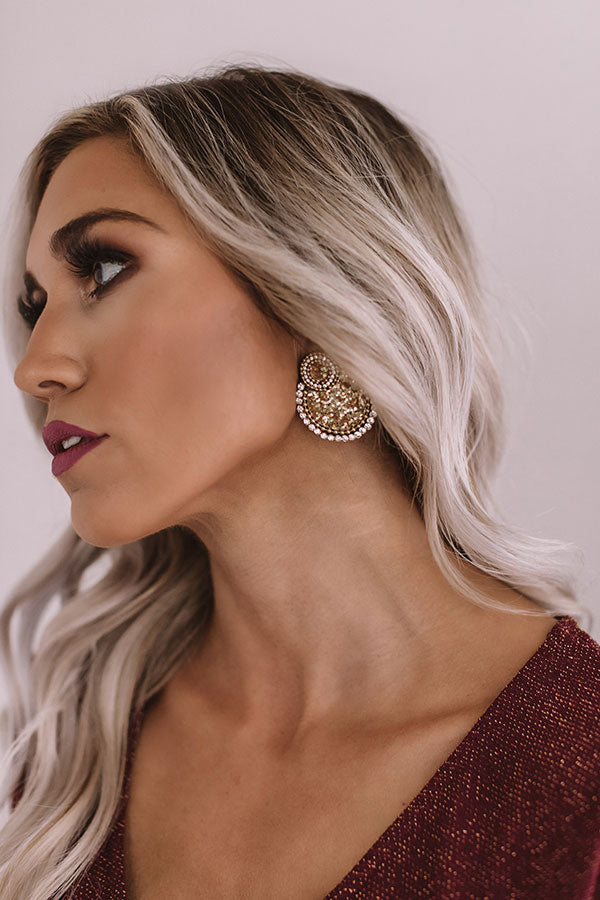 Turn On The Charm Earrings In Gold